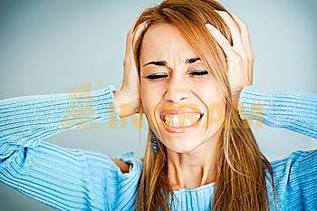 frustrated woman covering ears with hands