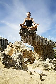 Hawaii, Kauai, Mahaulepu, Woman doing yoga.