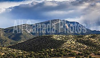 storm passes over the sandia mountains, viewed from placitas; new mexico, united states of america
