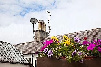 chimney and satellite dish on a roof; avoca, county wicklow, ireland