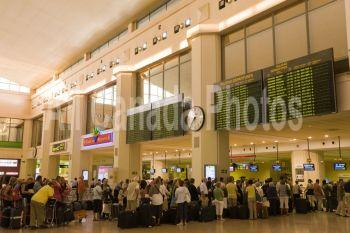 Queue to check in desk at airport; Malaga, Costa del Sol, Spain